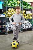 Boy with soccer ball in sport store Royalty Free Stock Images