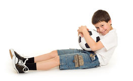 Boy with soccer ball. Studio isolated Royalty Free Stock Image