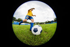 Boy soccer player hits the ball Royalty Free Stock Photos