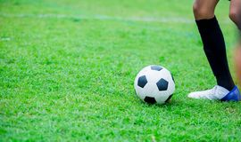 Boy soccer player speed run to shoot ball to goal on green grass. Soccer player training or football match stock photos