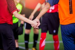 Boy soccer players tap hands together for football training. Soccer players and goalkeeper training speed hand together stock images