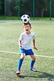 Boy soccer playing with ball Royalty Free Stock Photography