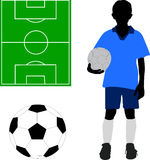 Boy in soccer uniform. Soccer ball, and playground Stock Images