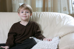 Boy on the sofa Royalty Free Stock Photo
