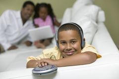 Boy on sofa Listening to portable CD player portrait Royalty Free Stock Image