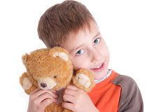 Boy with soft toy Royalty Free Stock Images