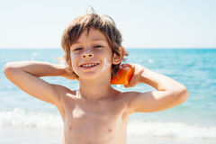 Boy with solar protection. Looking at camera Royalty Free Stock Photo
