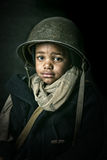 Boy soldier. Young boy soldier portrait with helmet royalty free stock image