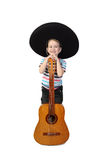 Boy in sombrero with guitar on white. Boy in sombrero stands behind big guitar on isolated on white background Royalty Free Stock Image