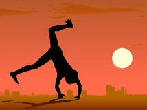 Boy somersault against sity skyline Stock Images