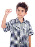Boy with something in hand Stock Photos