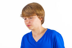 Boy in sorrow. Cute boy with blue shirt in sorrow royalty free stock images