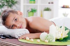 Boy in spa treatment Stock Photo