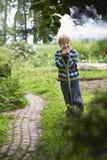 Boy With Spade In Garden Stock Photo
