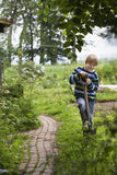 Boy With Spade In Garden Stock Images