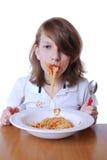 Boy with Spaghetti. Smiling boy eats a portion of spaghetti napoli Royalty Free Stock Image