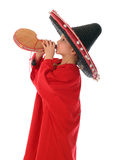 Boy in spanish red shirt and sombrero drinking from bota bag Stock Photography