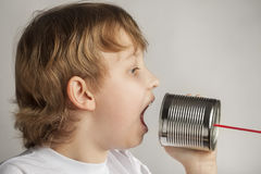 Boy speak in tin can telephone Stock Photography