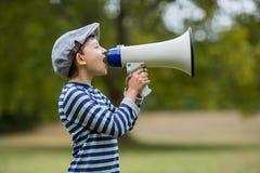 Boy speaking on megaphone Royalty Free Stock Photo