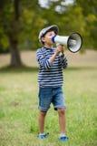 Boy speaking on megaphone Stock Images