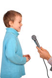 Boy speaks into  microphone Stock Images