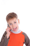 Boy speaks by phone Stock Photography