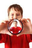 Boy and special glass as original portrait Stock Photo
