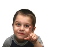 The boy specifies a finger. The boy has lifted upwards an index finger Royalty Free Stock Photo
