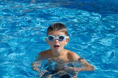 Boy with spectacles in the swimming pool Royalty Free Stock Photography