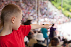 Boy among the spectators at representation Royalty Free Stock Photos