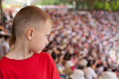 Boy among the spectators at representation Royalty Free Stock Photo
