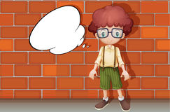 A boy and a speech bubble. Illustration of a boy standing in front of a wall Stock Photo