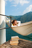 Boy speeping on hamaca. Boy relax at the lake on the hammock Royalty Free Stock Image