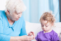 Boy spending time with grandma Royalty Free Stock Images