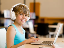 Boy spending time with notebook Royalty Free Stock Images