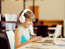 Boy spending time with notebook Stock Photography