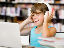Boy spending time with notebook Stock Images