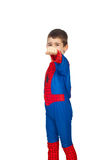 Boy in spider costume showing fist hand. Boy with facial expression and dressed in spider costume showing fist hand isolated on white background.Check also Stock Photography
