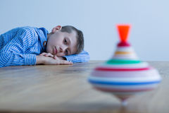 Boy and spinning top Royalty Free Stock Photography