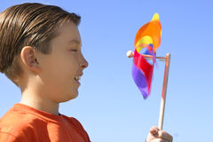 Boy with a spinning wheel pinwheel Royalty Free Stock Photo