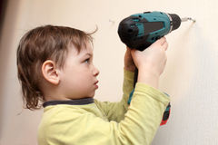 Boy spins the screw Stock Images