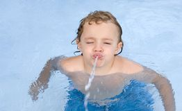 Boy Spitting Water royalty free stock photos