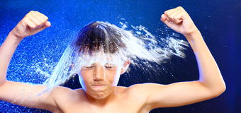 Boy and splash royalty free stock photography