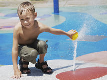 Boy at splash zone Stock Image