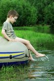 Boy splashing. Boy splash on rubber dinghy Royalty Free Stock Photo