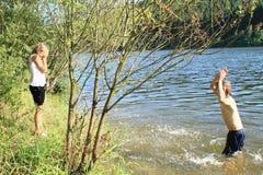Boy splashing a girl Stock Photography