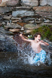 Boy splashing in a lake Royalty Free Stock Photography