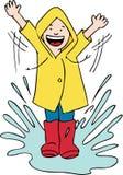 Boy Splashing in Puddle Royalty Free Stock Photo