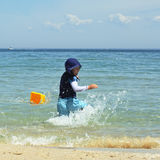 Boy splashing water Stock Photo