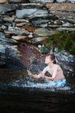 Boy splashing water Royalty Free Stock Image